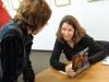 Carol Ann Davis signing her book